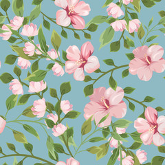 Seamless pattern with pink flowers on a blue background