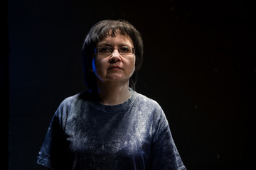 Portrait of brunette woman with black background