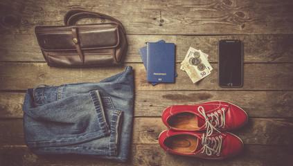 Traveling concept - essencials, camera, phone, plane