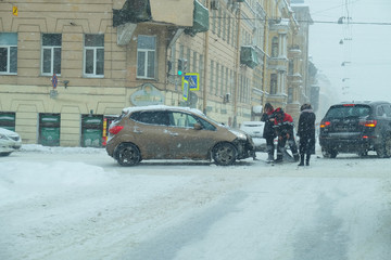 collision of cars at the snow-covered intersection of the city