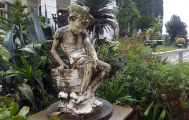 Ancient statue in front of Achilleion palace of Empress of Austria Elisabeth of Bavaria in Corfu island, Greece