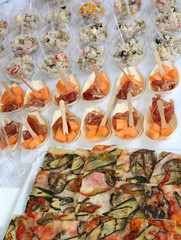 buffet with rice pizza and ham with melon during the wedding reception