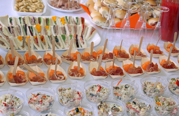 rice and ham with melon and many sandwiches during the wedding reception