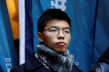 Pro-democracy activist Joshua Wong poses outside the Court of Final Appeal in Hong Kong
