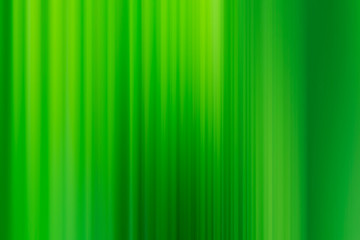 abstract blurred background with vertical emerald green strips
