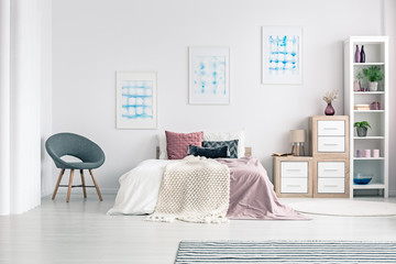 Armchair in pastel bedroom interior