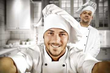The cook's helper takes a picture of herself and the chef.