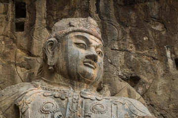 Close-up The face Stone Buddha Statue Carved from the mountains.