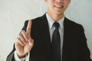 businessman press transparent button on virtual screen. man click on touchscreen. business, technology, internet concept