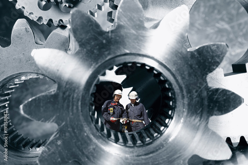 Wall mural giant gears and cogs used in the aerospace and rocket industry wirh industry workers