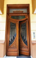 Old wooden brown house door dark wood