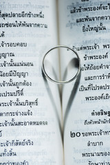 Love ring on the book.