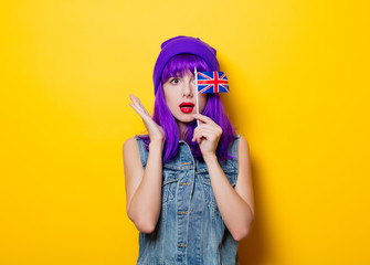 girl with purple hair holding Great Britain flag