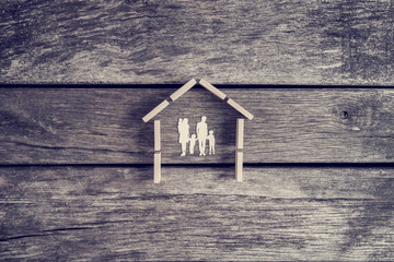Property or real estate concept with a cut out of a family with children