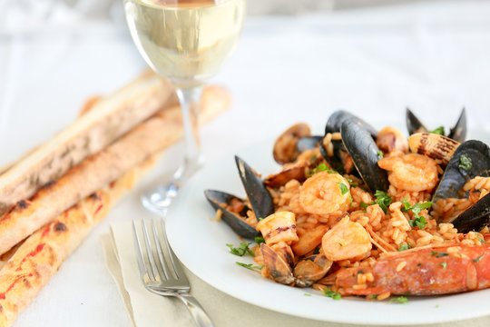risotto with seafood and tomato, italian food