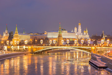 Illuminated Moscow Kremlin and Moscow River in Frosty Winter Evening.