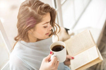 Book and drinks. Woman reading book white having a cup of fragrant coffee. Relaxed mood lovely hobby time.