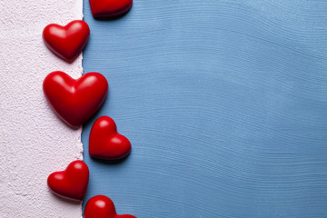 Red hearts on blue and pink plastered background