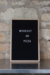"""letterboard with """"workout or pizza"""""""
