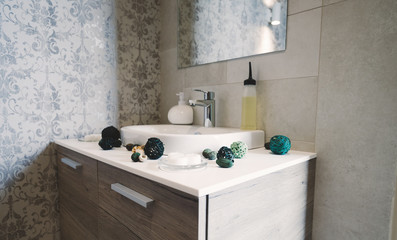 Sink and tap with soap and decoration