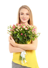 Beautiful young woman with bouquet of roses on white background