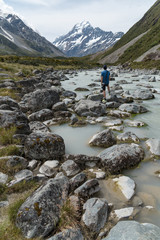 Young male photographer look up to Mount Cook, New Zealand