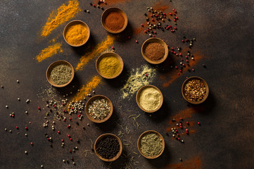 A Variety of Middle Eastern Spices are Displayed in Wooden Bowls