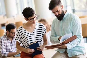 Young woman and man studying for an exam.