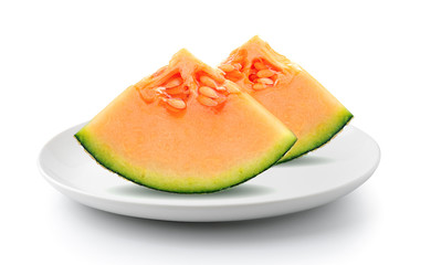 melon in plate isolated on a white background