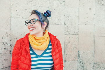 Happy beautiful fashion hipster woman with colorful hair laughing