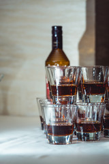 Pyramid of glasses of alcohol made in a pyramid for event party or wedding ceremony