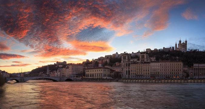 Colorful sunset over Vieux Lyon and the the Saone river at Quai des Celestins. Lyon, France.