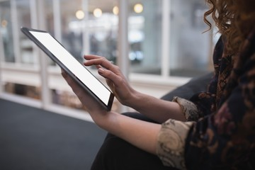 Female executive using digital tablet in office