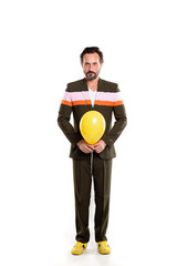 Happy man full length isolated on white background. Holding yellow balloon.