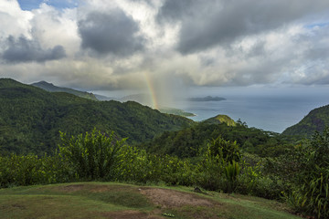 rainbow and rain over the jungle and mountains of mahé, seychelles 8