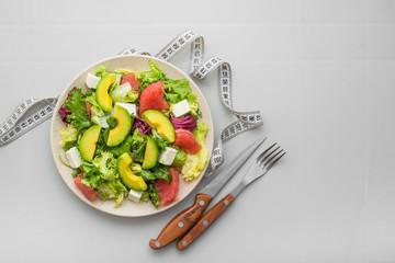 Fresh healthy salad with avocado, grapefruit