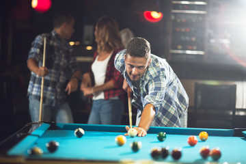 Pool  player ready for the shot