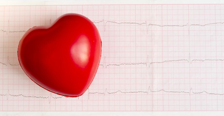 the figure of the red heart on the background of the cardiogram chart. health. cardiovascular diseases. diagnostics.