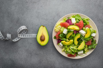 Fresh avocado fruit with white measuring tape