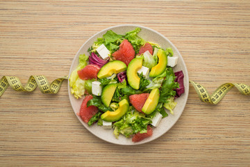 Fresh salad with avocado and fruits