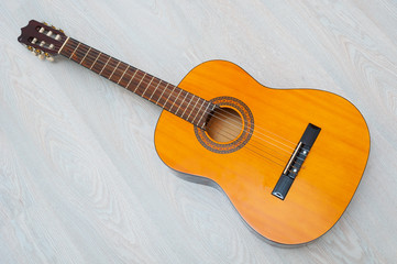 Top view yellow acoustic guitar