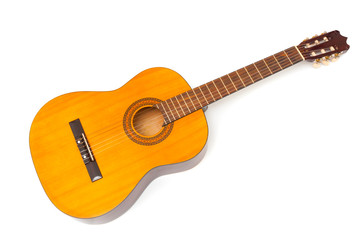 Yellow acoustic guitar closeup on white background