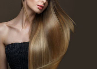Wall Mural - Beautiful blond girl with a perfectly smooth hair, classic make-up. Beauty face. Picture taken in the studio on a white background.
