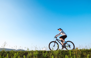 Woman ride a bicykle