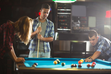 Young friends at a billiard club having a good time