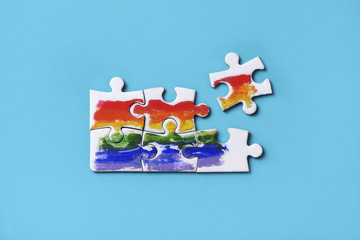 puzzle pieces forming a rainbow flag