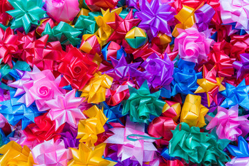 Colorful ribbon flowers for giving alms to make merit in Thai's religious traditional