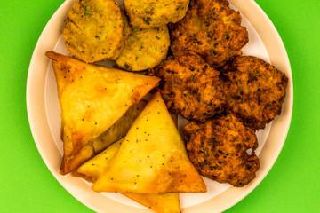 Selection of Indian Snacks Vegetarian Onion Bhaji Samosas and Tikka