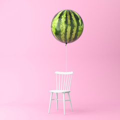 Balloon watermelon with chair concept on pastel pink background. minimal idea food and fruit concept. An idea creative to produce work within an advertising marketing communications or artwork design.