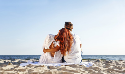 Valentine day on beach and two lovers